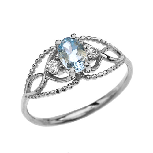 Elegant Beaded Solitaire Ring With Aquamarine Centerstone and White Topaz in White Gold