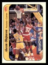 1986-87 Fleer Stickers #9 Akeem Olajuwon Near Mint  ID: 320631