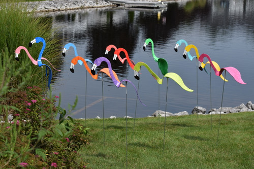 "Flamingos dancing garden art that moves with the wind atop 35"" stakes, made in Michigan, USA."