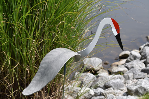 """Sandhill Crane dancing garden art that moves with the wind atop a 35"""" stake, made in Michigan, USA."""