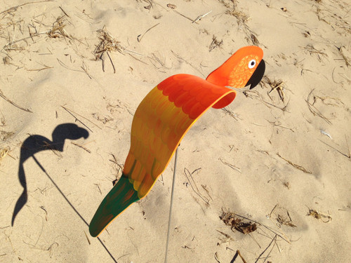 """Orange Parrot dancing garden art that moves with the wind atop a 35"""" stake, made in Michigan, USA."""