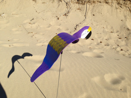 """Purple Parrot dancing garden art that moves with the wind atop a 35"""" stake, made in Michigan, USA."""