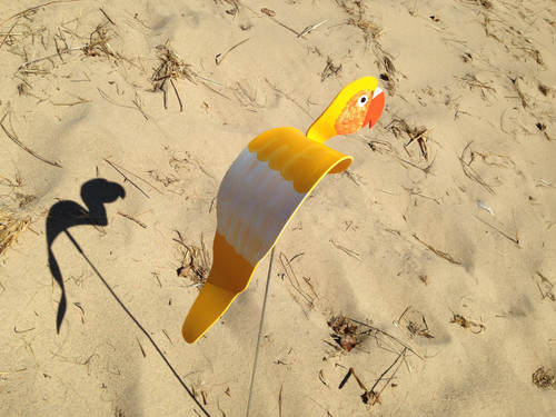 """Gold Parrot dancing garden art that moves with the wind atop a 35"""" stake, made in Michigan, USA."""