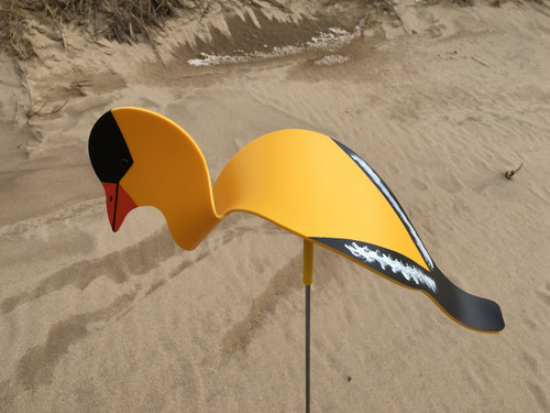 """Goldfinch dancing garden art that moves with the wind atop a 35"""" stake, made in Michigan, USA."""