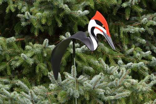 """Pileated Woodpecker dancing garden art that moves with the wind atop a 35"""" stake, made in Michigan, USA."""