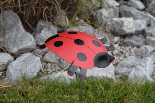"Ladybug dancing garden art that moves with the wind atop a 17.5"" stake, made in Michigan, USA."