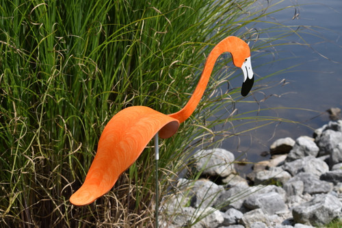 """Flamingos dancing garden art that moves with the wind atop 35"""" stakes, made in Michigan, USA."""