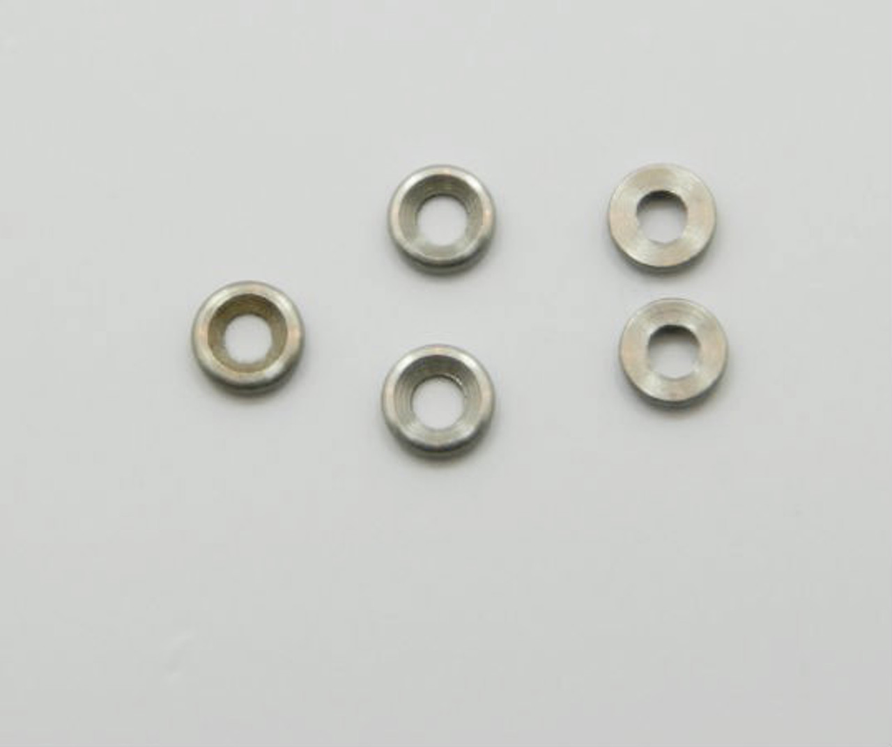 """Washer, metal inside hole 0.048"""" / 1.2mm outside diameter 0.105"""" / 2.6mm use with thread sizes  M1.0 to M1.2 and 000-120, 00-96 and 00-90 Material: Nickel silver a copper alloy resistant to tarnish often used in Jewelry and Eyewear part color is silver. Packaged Price per 100 pieces with bulk pricing available."""