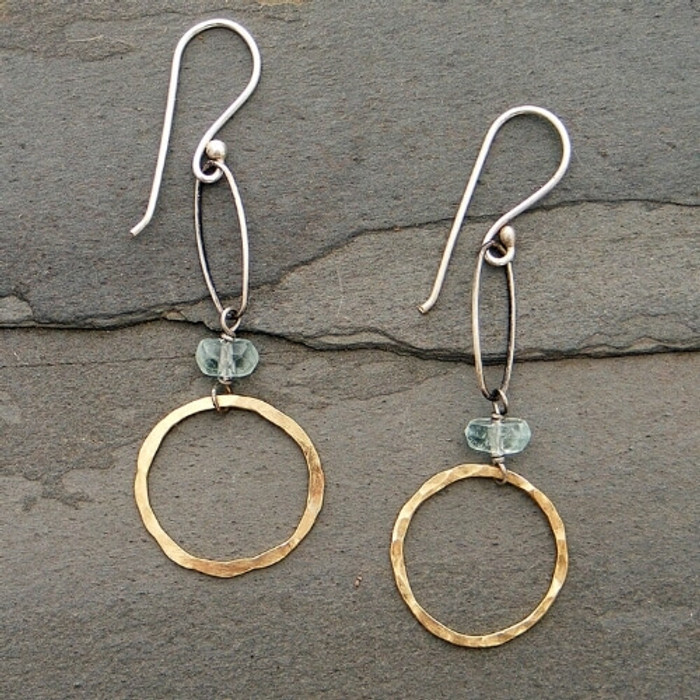 Hammered gold hoop earrings with aquamarine stones