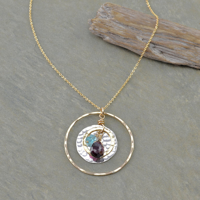 Unique handmade necklace with garnet gemstone and hammered sterling silver disk: view 1