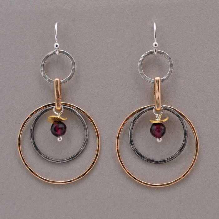 artistic handmade hoop earrings made with faceted red garnet gemstones