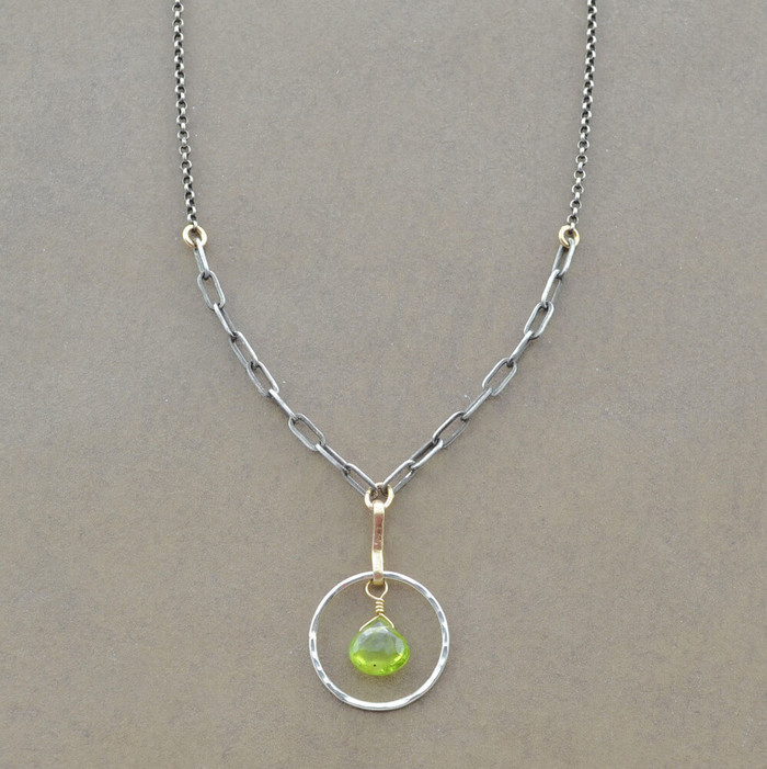Unique peridot gemstone necklace made with hand hammered sterling silver circle: view 1