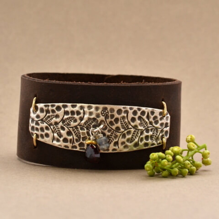 Stamped floral and charms wide leather cuff