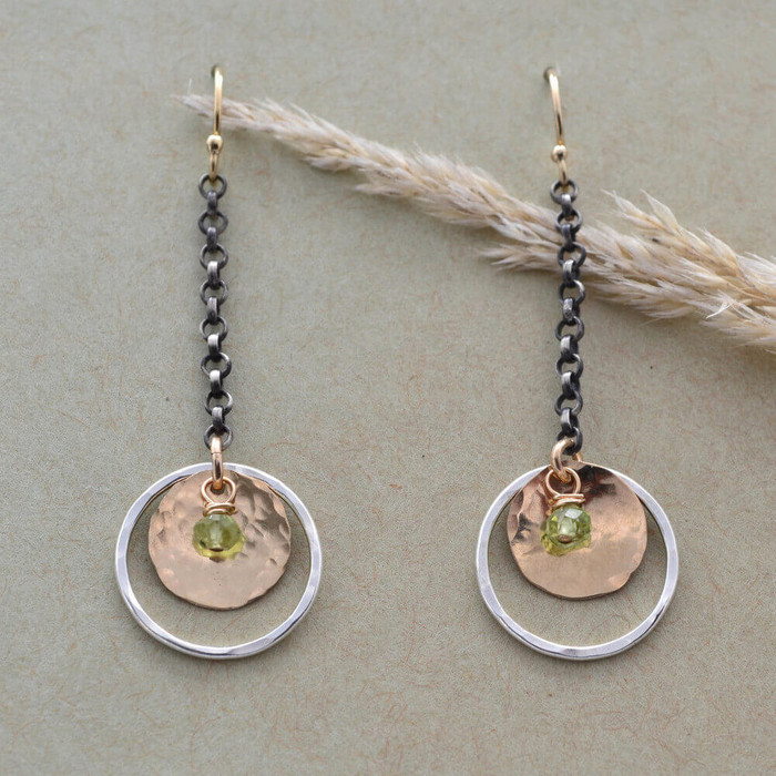 Handmade sunrise earrings made with peridot gemstone and sterling silver circle