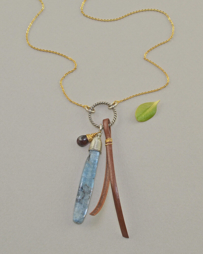 Unique free bird necklaces made with kyanite stone and gold fill chain: view 1