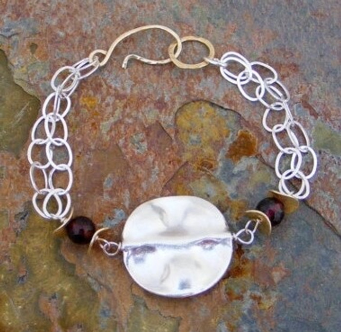 Unique handmade bracelets with sterling silver chain and faceted garnet gemstones