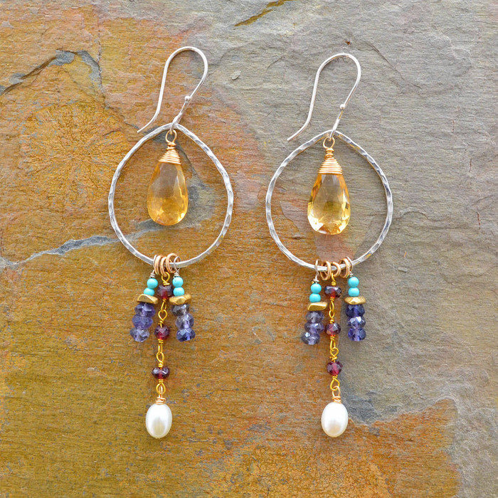 Handcrafted sterling silver earrings with various kinds of gemstones