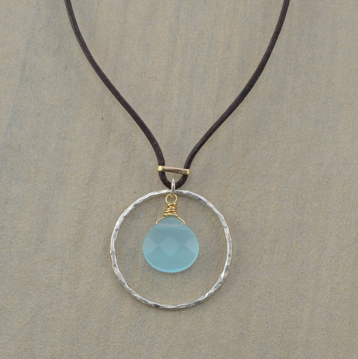 Unique handmade leather necklace with sterling circle and chalcedony stone in the center view 1
