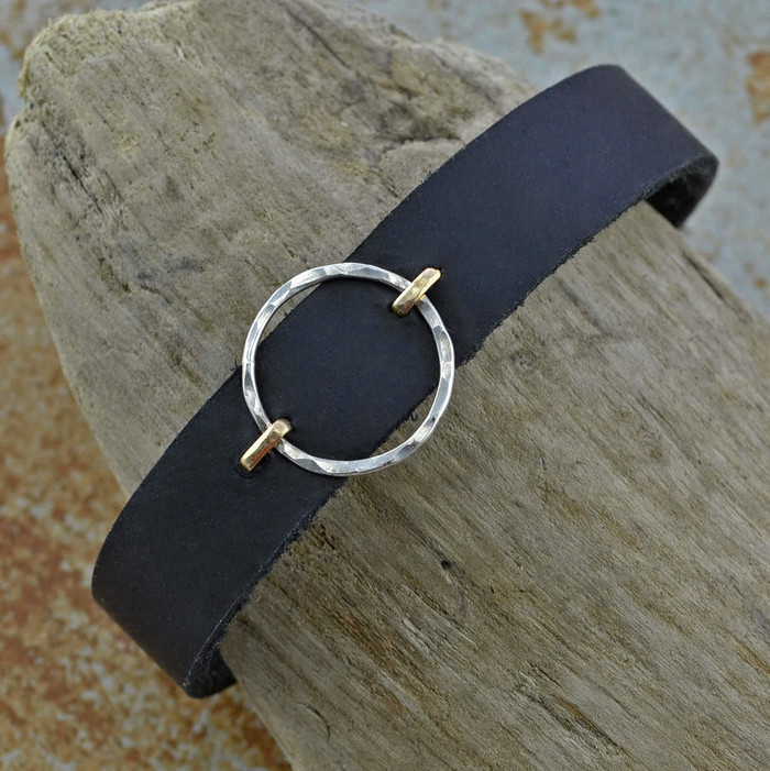 simple but elegant leather bracelet cuffs featured with sterling silver circle suspended between 14/20k gold filled stems: view 1