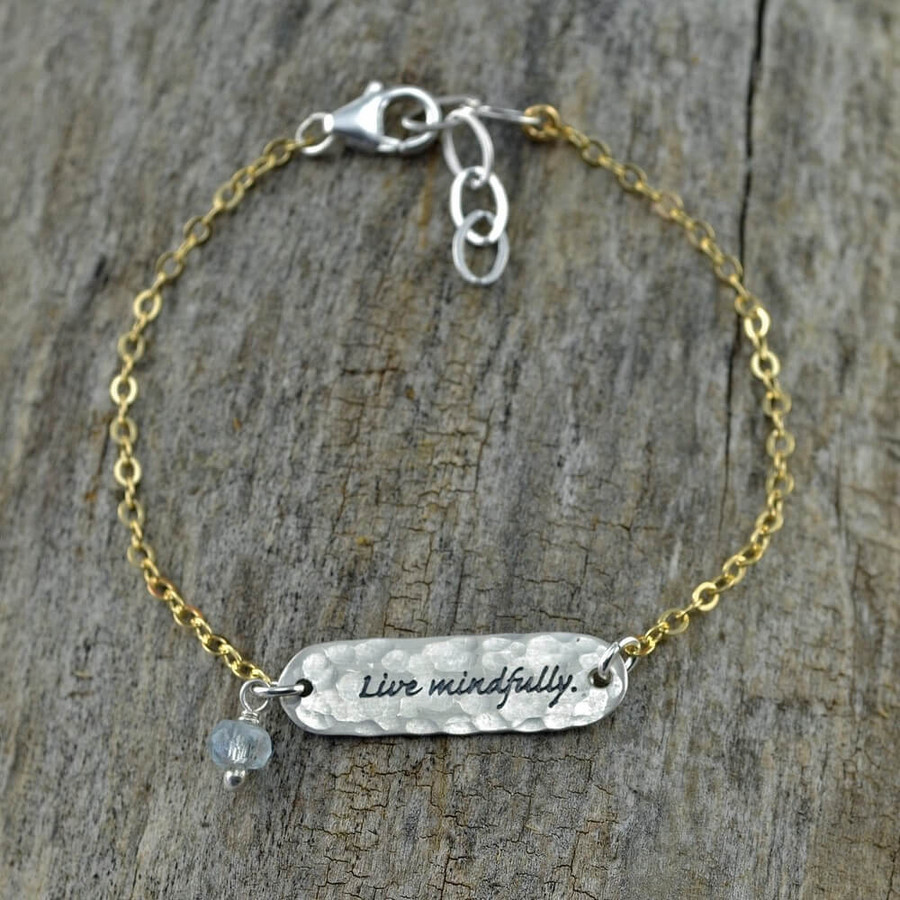 "Unique handcrafted bracelets with the inscribed phrase ""Live Mindfully"""