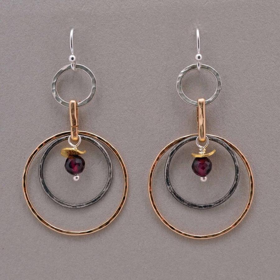 artistic handmade hoop earrings made with faceted red garnet gemstones