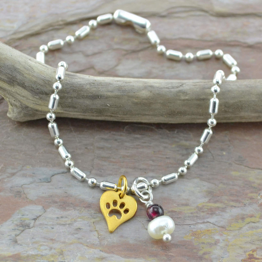 Handmade dog paw bracelet made with garnet and pearl gemstone: view 1
