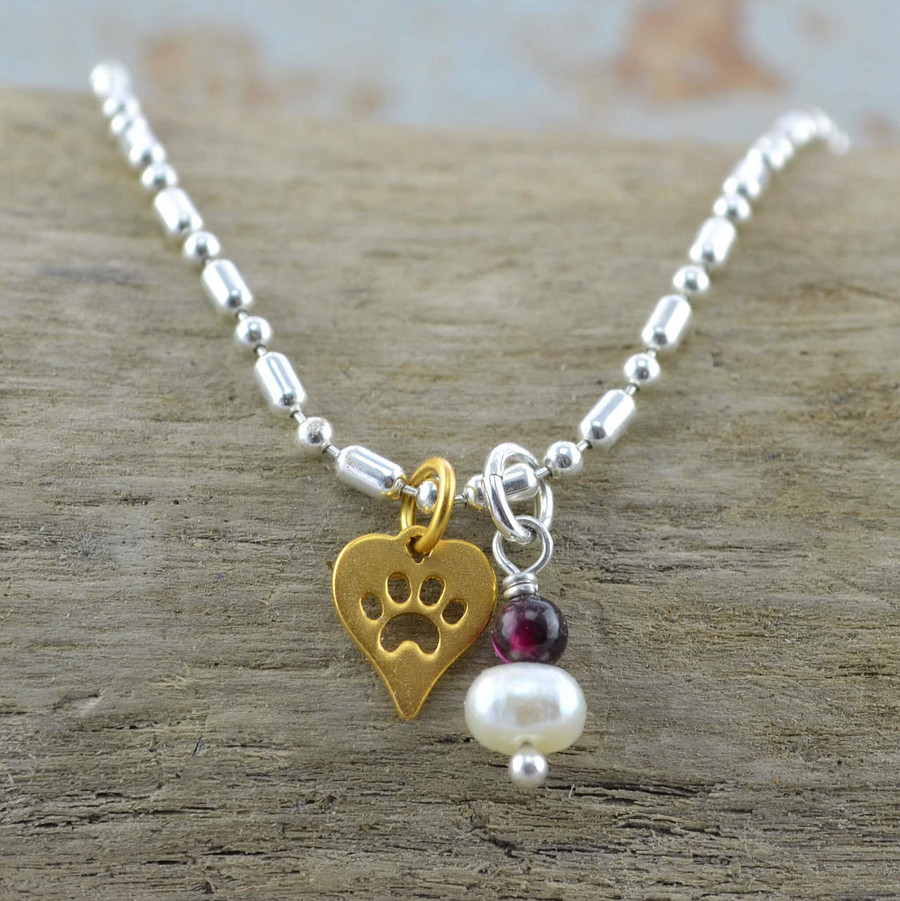 Handmade dog paw bracelet made with garnet and pearl gemstone: view 2
