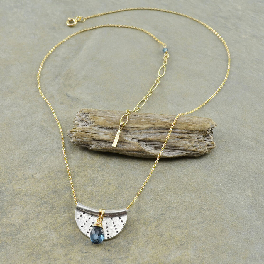 Handcrafted crescent moon necklace made with stamped sterling silver and a blue topaz gemstone: view 2