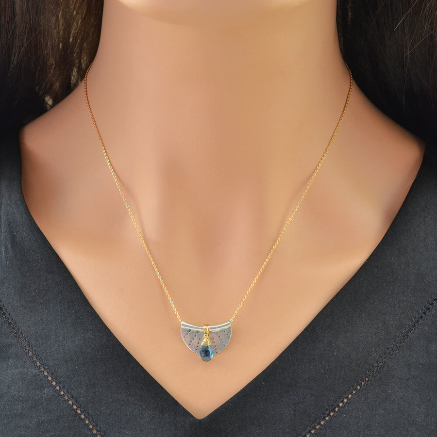 Handcrafted crescent moon necklace made with stamped sterling silver and a blue topaz gemstone: view 3