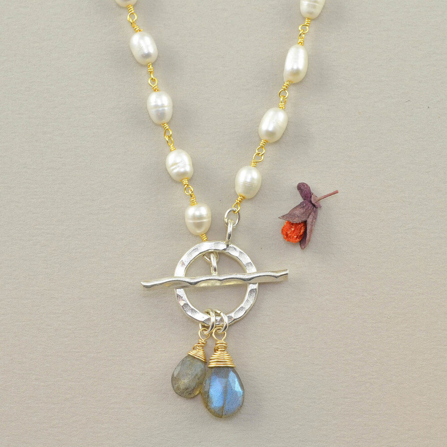 Handcrafted blue sky necklace made with pearls and two labradorite stones