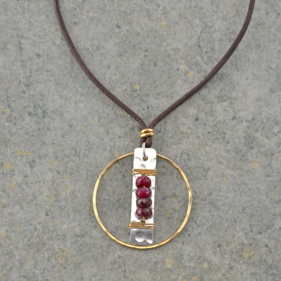 handmade leather faceted garnet necklace with four garnet stones wrapped to a sterling silver: view 1