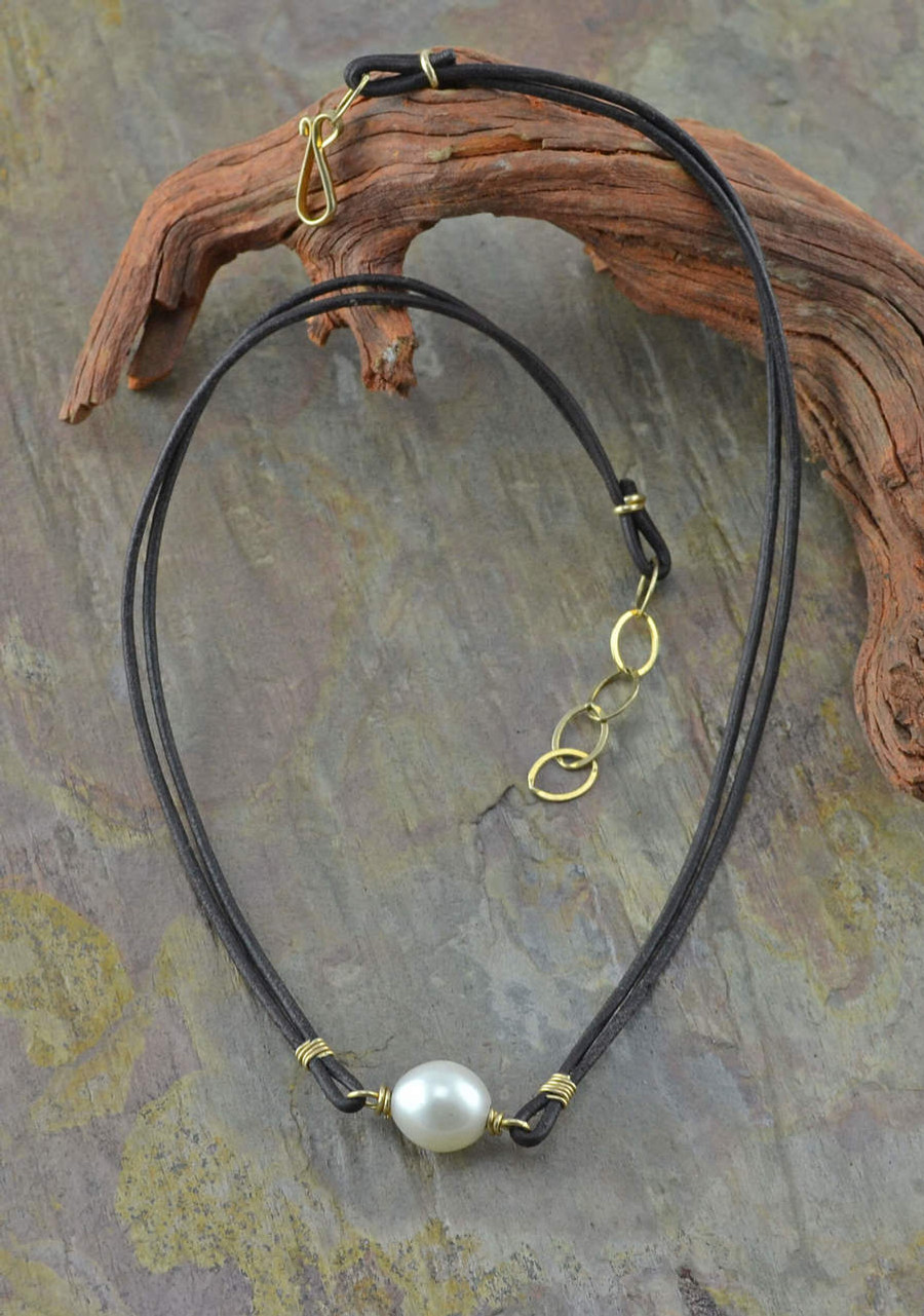 Handmade pearl necklace suspended between two leather cords: view 2