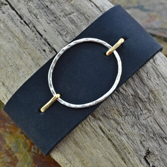 black-leather-and-silver-circle-cuff.jpg