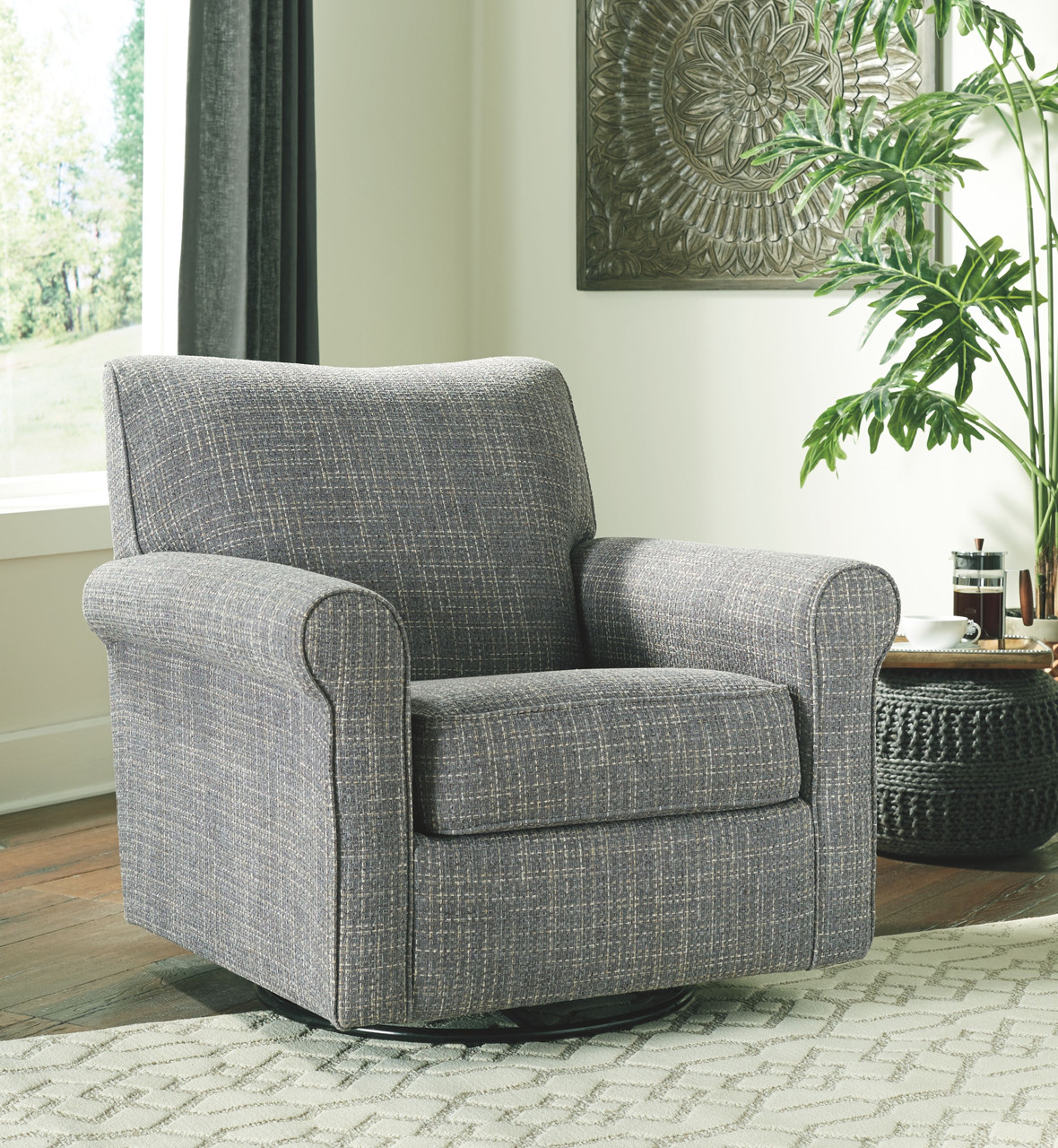 Renley Ash Swivel Glider Accent Chair On Sale At American Furniture Of Slidell Serving Slidell La