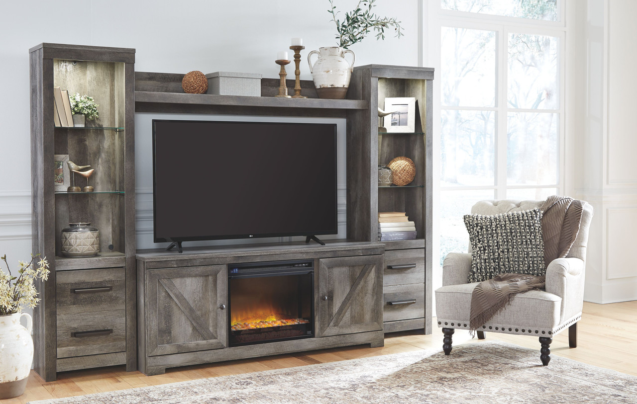 Wynnlow Gray Lg Tv Stand 2 Piers Bridge With Glass Stone Fireplace Insert On Sale At American Furniture Of Slidell Serving Slidell La