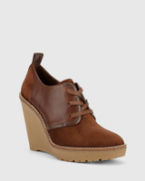 Tablyn Brown Suede and Leather Round Toe Wedge Bootie.
