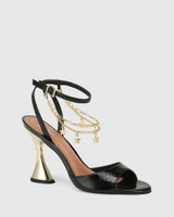 Veeva Black Crinkle Patent With Gold Flared Heel Sandal