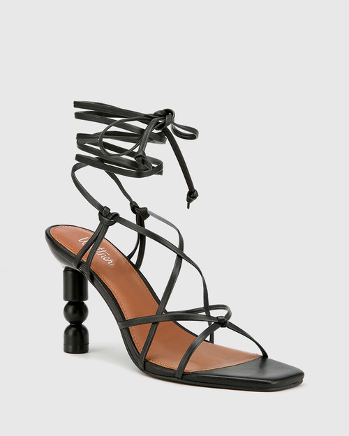 Rikita Black Leather Sculptured Heel Strappy Sandal.