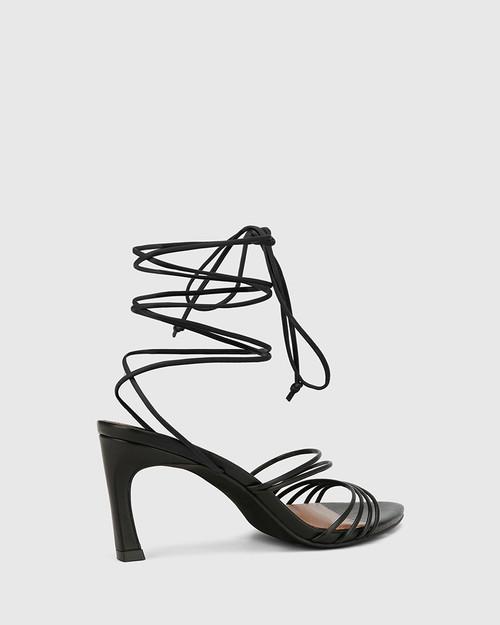 Raelynn Black Leather Strappy Sandal.