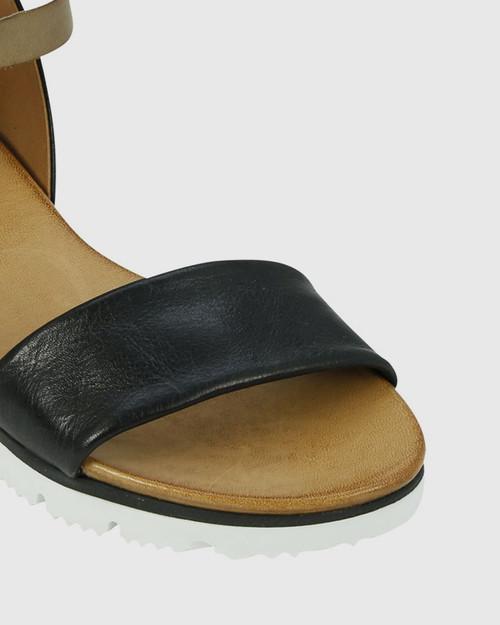 Soda Black Leather Ankle Strap Wedge Sandal.