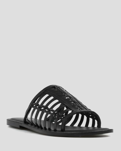 Ilex Black Leather Slip On Flat Sandal.
