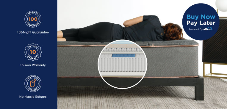 A woman laying on a Tommie Copper Mattress.