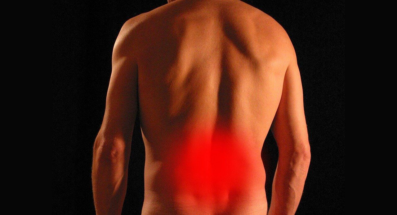 A man with glowing red indicating lower back and hip pain needing relief