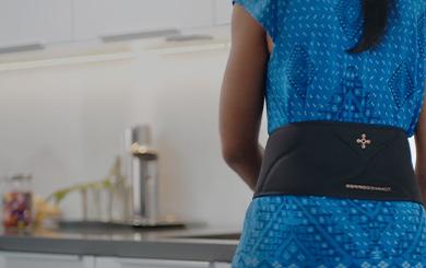 Woman wearing back brace.