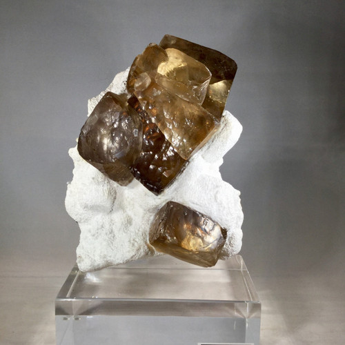 Golden Calcite Cubes embedded in Snowy White Mordonite on Matrix