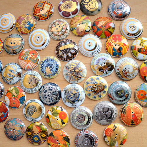 Example fired buttons with antique map decals on them