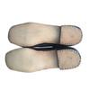 Bottom sole/heel detail of brogan