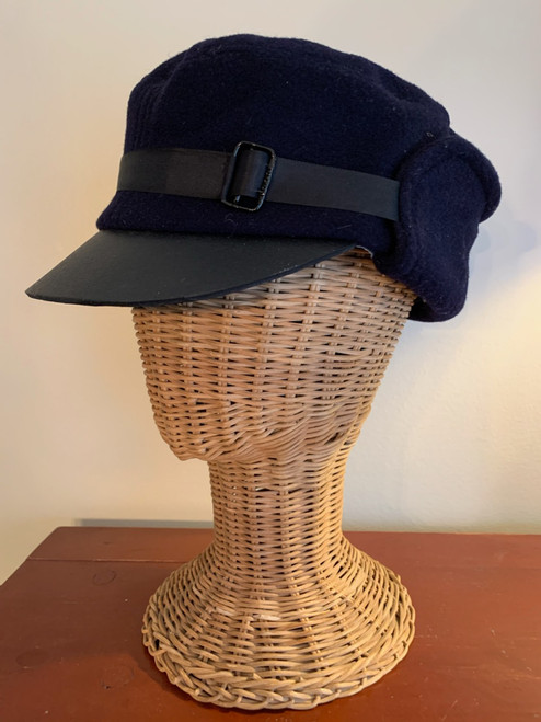 Winter cap with ribbon and buckle