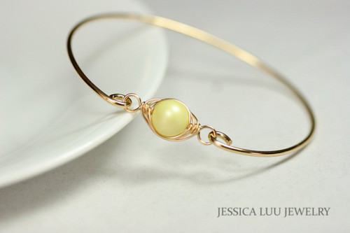 handmade 14k yellow gold filled wire wrapped bangle bracelet with pastel yellow Swarovski pearl by Jessica Luu Jewelry
