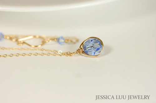 14K yellow gold filled wire wrapped necklace with light sapphire Swarovski crystal pendant handmade by Jessica Luu Jewelry
